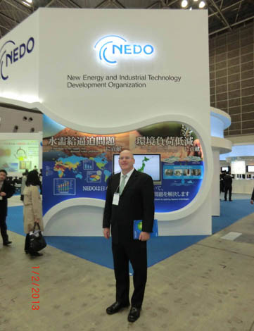 ATIP consultant Rob Haak (InsightInterAsia) at nanotech Japan 2013 exhibition, in front of the booth for Japan's New Energy and Industrial Technology Development Organization (NEDO)