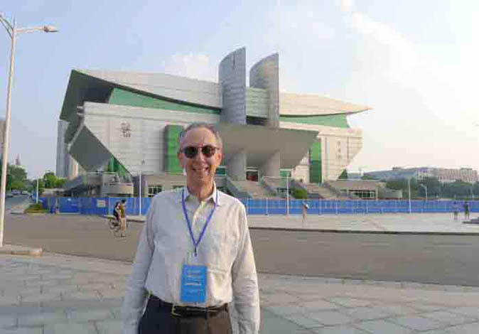 ATIP President Dr. David Kahaner in front of the gymnasium on the campus of China's National Univeristy of Defense Technology (NUDT), developer of the #1 supercomputer on the most recent Top500 List, the Tianhe-2 (TH-2).