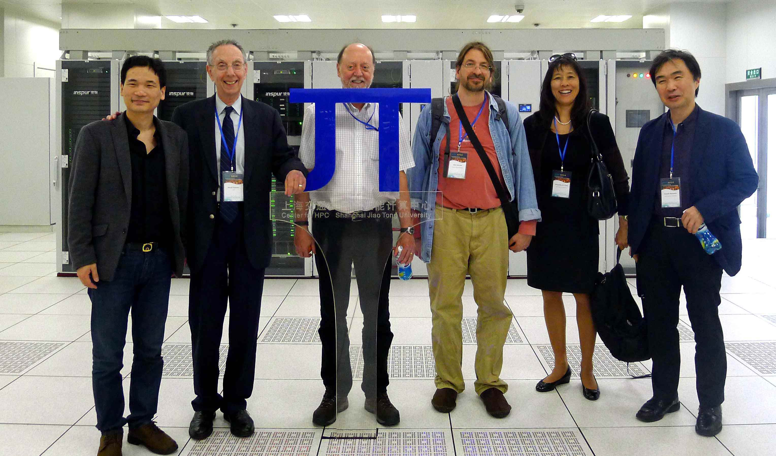 Dr. David Kahaner (the second from the left), President of ATIP, in front of the ∏ system at the HPC Center of Shanghai Jiao Tong University, together with Prof. Xinhua LIN (Vice Director, Center for HPC, Shanghai Jiao Tong University), and other attendees of ICSC 2014 conference